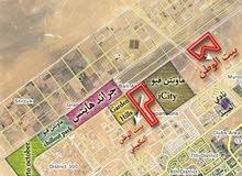 أرض للبيع فررررصة بالتوسعات الشمالية 276م بها قواعد ومسلحة وخالصة الاقساط