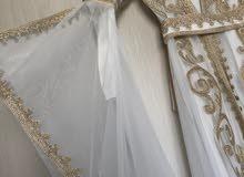 white abaya with gold