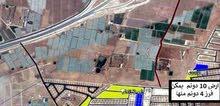 قطعة أرض مميزة في منطقة الذهيبة الغربية على طريق المطار على شارع المية الجديد للــبـيـع