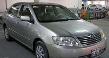 Toyota Corolla 2005 model, Beige (Golden) color, well-maintained.