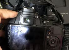 نيكون مستخدمه 3100D بدون عدسه الكامره جديده