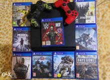 Ps4 500gb in very good condition with 2 original joysticks and 9 cds!!