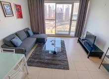 دبي بيزنس باي غرفة وصالة مفروشة مع بلكونة - ايجار شهري