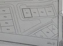 سكني تجاري مساحة 1200 سفاري / حي عاصم بجانب بنايات قائمه