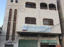 مخازن / عماره للبيع مؤته شارع الجامعة /الكرك