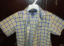 اي قميص صيفي ولادي امريكي بدينار من 6 ل 7سنوات