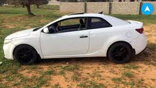Kia Koup 2010 For sale - White color