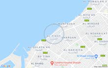 special commercial land in front of corniche sharjah