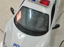 Police car toy with remote wheel, brakes and traffic lights