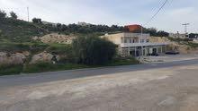 ناعور (العمريه) – ارض بمساحة 4106 متر على شارع ناعور الرأيسي باتجاه دار الدواء
