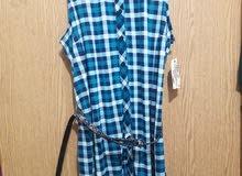 قميص جديد  لون ازرق نمره XL / قميص جديد لون بيج نمره L