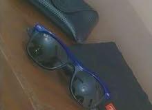 نظارة شمس ray ban أصلية أستعمال شهرين بجميع مستلزماتها