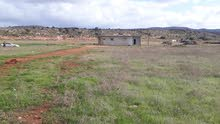 قطعة أرض بمساحة نص اكتار  5000 متر