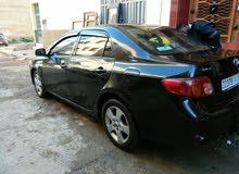 Toyota corolla 2010 ttes opts 5cv vitres électriques. jantes alu. contacter