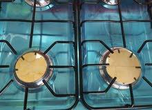 غاز 4 عيون مع فرن نوع ناشونال دريم لون اسود وابيض بسعر مميز 95 دينار