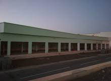 محلات تجارية عدد 12 محل + مخزن مساحة 1350 متر.
