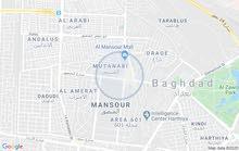 ارض خلف التجاري جوارها محلات وقيصرية نافذة من الشارع العام  خلف مصور مجدي