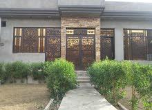 دار للبيع مساحته 200م والبناء 120م في بغداد حي البساتين
