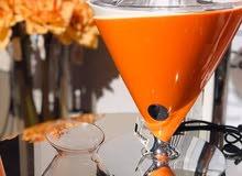 معصرة البرتقال الكهربائية