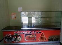 بضاعة محل حلويات للبيع
