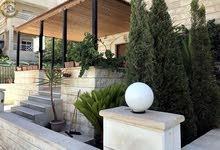 شقة ارضية مميزة للبيع في الرابية 200م مع حديقة وترسات 60م تشطيب سوبر ديلوكس