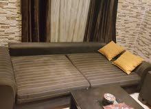 غرفة جلوس تتحول الى سرير + مكتبة+ طاولة