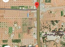 ارض مساحته 1550 متر طريق قصربن غشير خلف سوق السبت