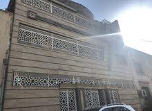 للبيع بنايه 200م بناء حديث درجة اولى في المنصور في حي المتنبي