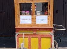 عربة لبيع المشروبات والسجائر