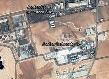 أرض للبيع صناعي لقطة 10 دونم و 200 م الجيزة خلف مصنع الحديد مباشرة