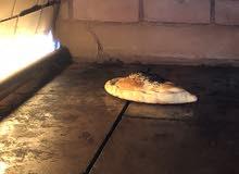 مطعم معجنات و بيتزا و مناقيش