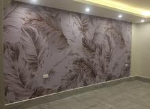 فنى تركيب استيكر وورق حائط