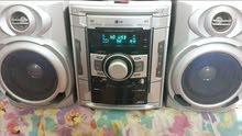 ستيريو ماركة LG كوري بيه DVD وراديو باحث و2 كاسيت وفلاش رام و اواكس مضخم صوت .
