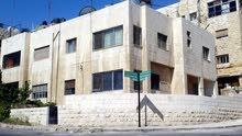 عمارة للبيع موقع مميز في جبل الحسين على شارعين رئيسيين