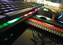 gaming keyboard and 2 mouses and mouse pad