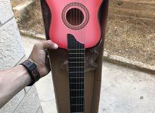 جيتار بيبي جديد بالكرتونه غير مستعمل فقط ب 15 دينار