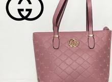 حقيبة ماركة كوتشي