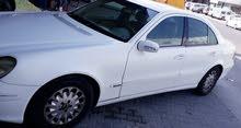 مرسيدس E240 موديل 2003 أبيض بحالة جيدة للبيع