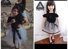 فستان اطفال رونزا من شركة كابرينا للملابس
