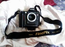 fujifilm S2 pro مع عدسة nikon 50mm 1.8 وعدسة nikon 180mm 2.8