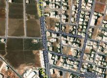 قطعة ارض للبيع ذات موقع مميز مقابل مجمع عمان الجديد عند حلويات حليم