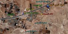 قطعة أرض مميزة للبيع تقع على شارع المطار - على شارع المية مباشرة قرب جامعة الإسراء