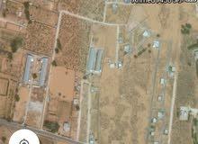 قطعة أرض مساحتها 450م للبيع او استبدال بسيارة الدار