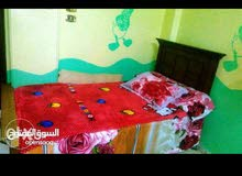غرفه اطفال مكونه من 2سرير و1دولاب