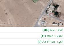 قطعة ارض للبيع في حي الزرقاء حي الاحمد مرتفعة ومطلة