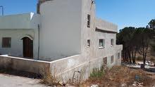 بيت مستقل للبيع في عجلون صخره غرب مسجد الصوفيه على دونم ارض