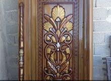باب حديد لون خشبي فاتح