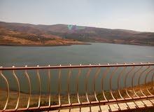 شقة للبيع في حمص منطقة وادي النصارى قرب جامعة الحواش الخاصة على سد المزينة جانب قلعة كنعان