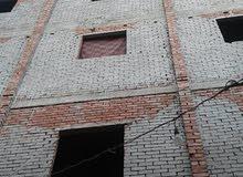 عماره كامله بها شقق طوب احمر مساحات مختلفه 75متر 180الف