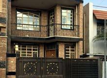 بيت للبيع شارع فلسطين حي المستنصريه